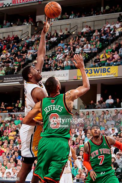 Roy Hibbert of the Indiana Pacers shoots against Jared Jeffries of the New York Knicks on March 17 2012 at Bankers Life Fieldhouse in Indianapolis...