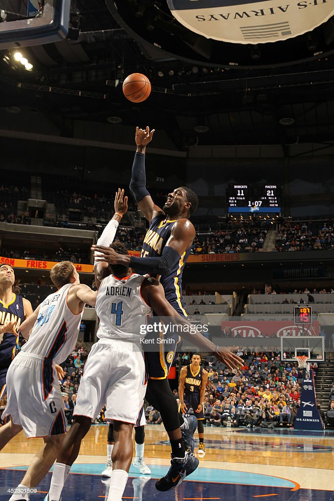 <a gi-track='captionPersonalityLinkClicked' href=/galleries/search?phrase=Roy+Hibbert&family=editorial&specificpeople=725128 ng-click='$event.stopPropagation()'>Roy Hibbert</a> #55 of the Indiana Pacers shoots against <a gi-track='captionPersonalityLinkClicked' href=/galleries/search?phrase=Jeff+Adrien&family=editorial&specificpeople=727235 ng-click='$event.stopPropagation()'>Jeff Adrien</a> #4 of the Charlotte Bobcats during the game at the Time Warner Cable Arena on November 27, 2013 in Charlotte, North Carolina.