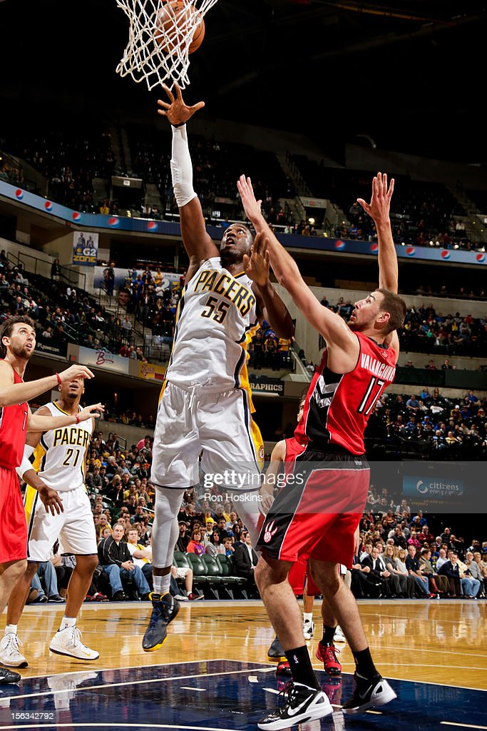 Roy Hibbert #55 of the Indiana Pacers shoots against Jonas Valanciunas #17 of the Toronto Raptors on November 13, 2012 at Bankers Life Fieldhouse in Indianapolis, Indiana.