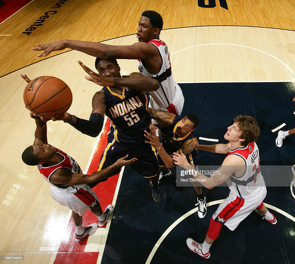 <a gi-track='captionPersonalityLinkClicked' href=/galleries/search?phrase=Roy+Hibbert&family=editorial&specificpeople=725128 ng-click='$event.stopPropagation()'>Roy Hibbert</a> #55 of the Indiana Pacers shoots against <a gi-track='captionPersonalityLinkClicked' href=/galleries/search?phrase=Kevin+Seraphin&family=editorial&specificpeople=6474998 ng-click='$event.stopPropagation()'>Kevin Seraphin</a> #13 and Jan Vesely #24 of the Washington Wizards during the game at the Verizon Center on November 19, 2012 in Washington, DC.