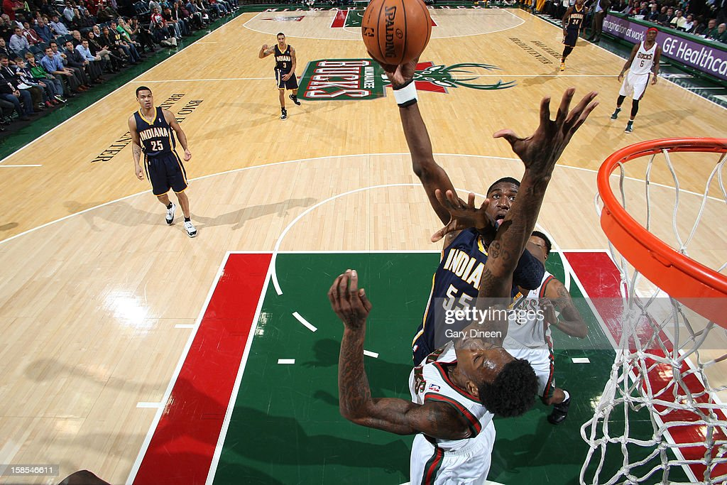 <a gi-track='captionPersonalityLinkClicked' href=/galleries/search?phrase=Roy+Hibbert&family=editorial&specificpeople=725128 ng-click='$event.stopPropagation()'>Roy Hibbert</a> #55 of the Indiana Pacers shoots against Larry Sanders #8 of the Milwaukee Bucks during the game on December 18, 2012 at the BMO Harris Bradley Center in Milwaukee, Wisconsin.