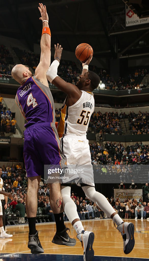 Roy Hibbert #55 of the Indiana Pacers shoots against Marcin Gortat #4 of the Phoenix Suns on December 28, 2012 at Bankers Life Fieldhouse in Indianapolis, Indiana.