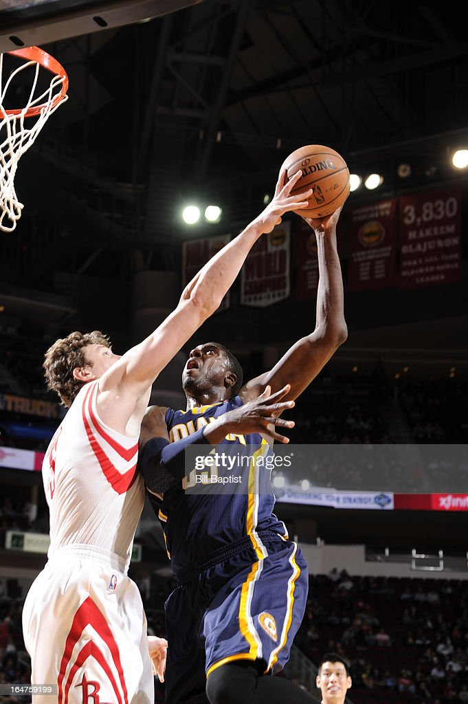Roy Hibbert #55 of the Indiana Pacers shoots against Omer Asik #3 of the Houston Rockets on March 27, 2013 at the Toyota Center in Houston, Texas.