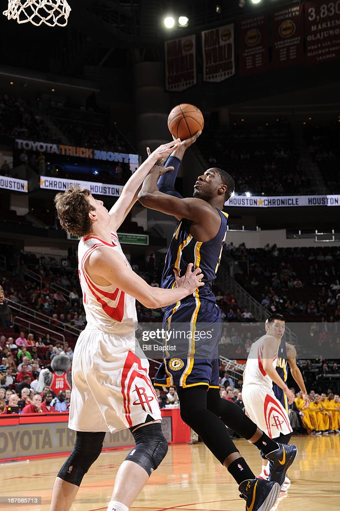 <a gi-track='captionPersonalityLinkClicked' href=/galleries/search?phrase=Roy+Hibbert&family=editorial&specificpeople=725128 ng-click='$event.stopPropagation()'>Roy Hibbert</a> #55 of the Indiana Pacers shoots against <a gi-track='captionPersonalityLinkClicked' href=/galleries/search?phrase=Omer+Asik&family=editorial&specificpeople=4946055 ng-click='$event.stopPropagation()'>Omer Asik</a> #3 of the Houston Rockets on March 27, 2013 at the Toyota Center in Houston, Texas.