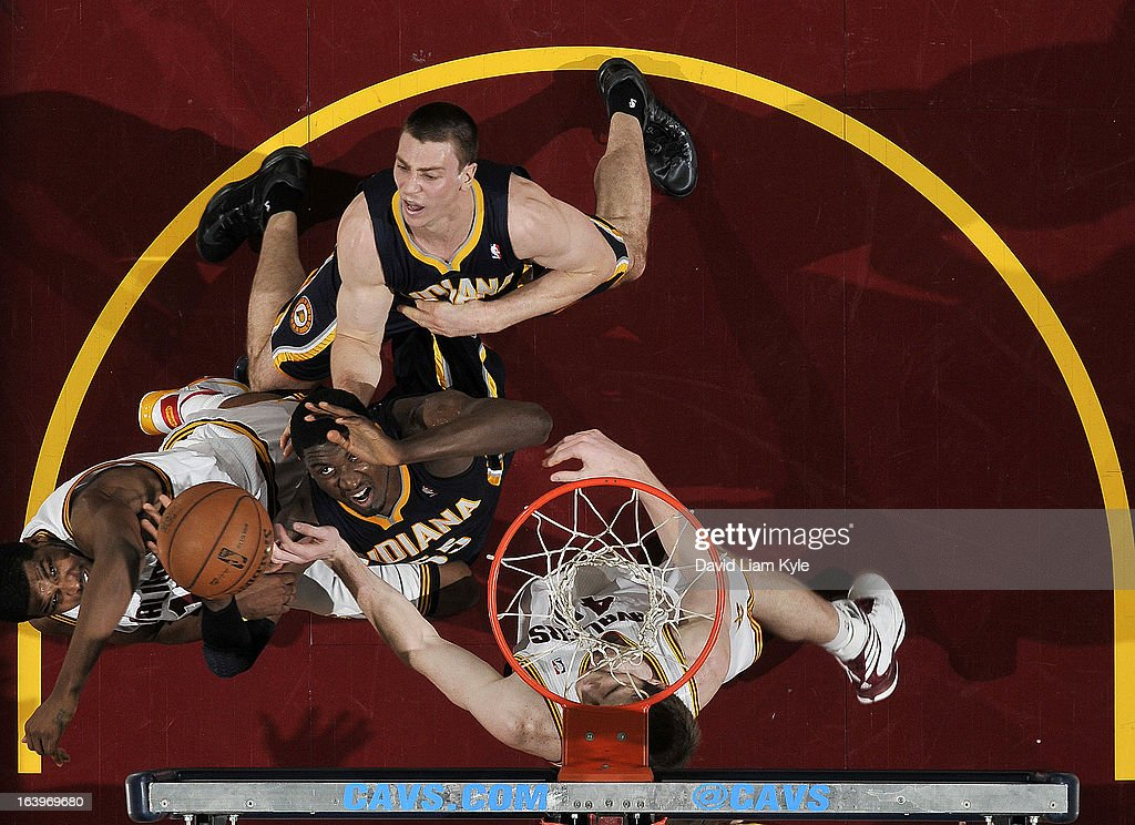 Roy Hibbert #55 of the Indiana Pacers shoots against Tristan Thompson #13 and Tyler Zeller #40 of the Cleveland Cavaliers at The Quicken Loans Arena on March 18, 2013 in Cleveland, Ohio.