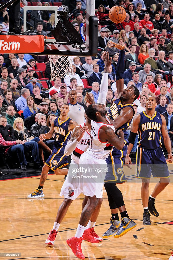 Roy Hibbert #55 of the Indiana Pacers shoots in the lane against J.J. Hickson #21 of the Portland Trail Blazers on January 23, 2013 at the Rose Garden Arena in Portland, Oregon.