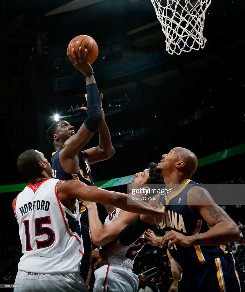 <a gi-track='captionPersonalityLinkClicked' href=/galleries/search?phrase=Roy+Hibbert&family=editorial&specificpeople=725128 ng-click='$event.stopPropagation()'>Roy Hibbert</a> #55 of the Indiana Pacers shoots over <a gi-track='captionPersonalityLinkClicked' href=/galleries/search?phrase=Al+Horford&family=editorial&specificpeople=699030 ng-click='$event.stopPropagation()'>Al Horford</a> #15 and <a gi-track='captionPersonalityLinkClicked' href=/galleries/search?phrase=Zaza+Pachulia&family=editorial&specificpeople=202939 ng-click='$event.stopPropagation()'>Zaza Pachulia</a> #27 of the Atlanta Hawks at Philips Arena on November 7, 2012 in Atlanta, Georgia.