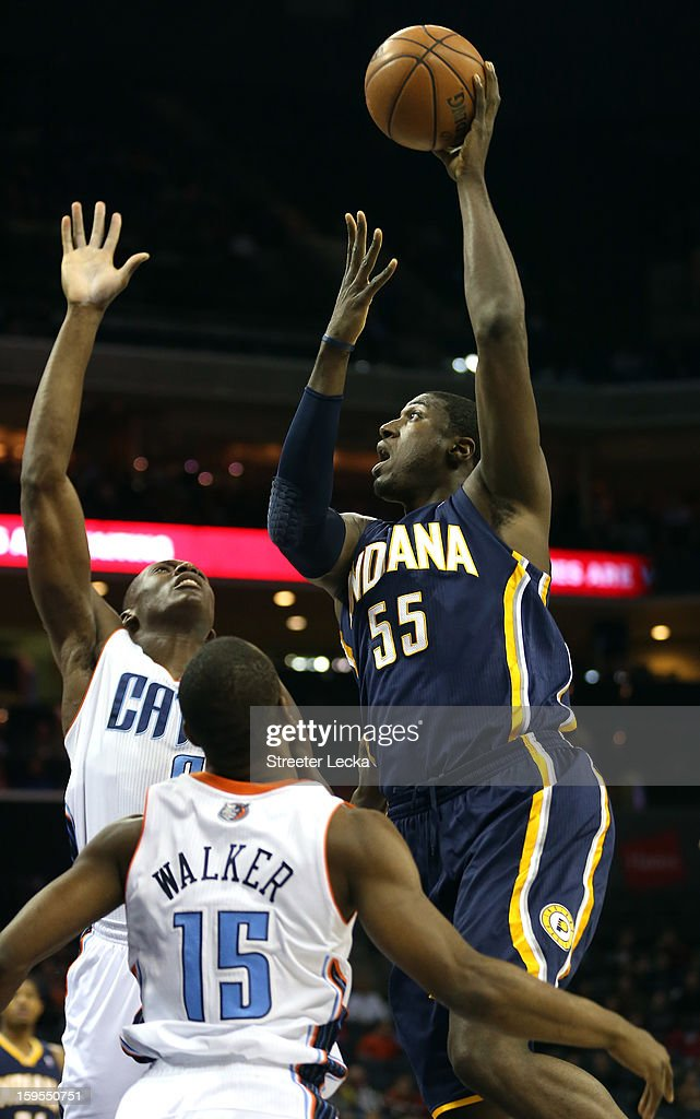 Roy Hibbert #55 of the Indiana Pacers shoots over teammates DeSagana Diop #2 of the Charlotte Bobcats and Kemba Walker #15 during their game at Time Warner Cable Arena on January 15, 2013 in Charlotte, North Carolina.