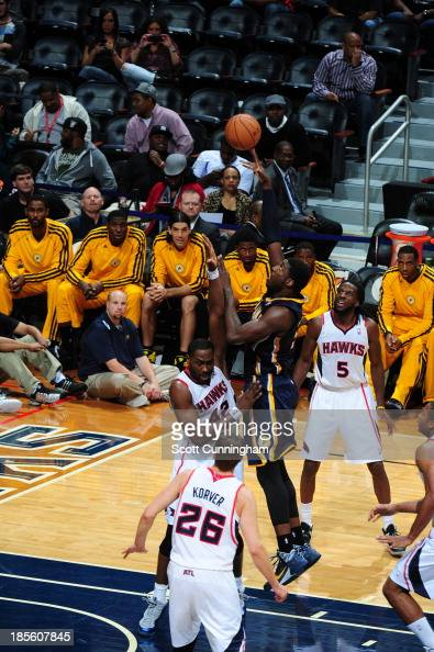 Roy Hibbert of the Indiana Pacers shoots the ball against Elton Brand and DeMarre Carroll of the Atlanta Hawks on October 22 2013 at Philips Arena in...