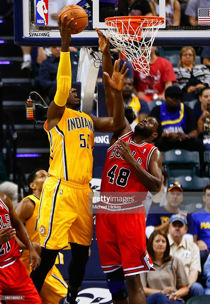 <a gi-track='captionPersonalityLinkClicked' href=/galleries/search?phrase=Roy+Hibbert&family=editorial&specificpeople=725128 ng-click='$event.stopPropagation()'>Roy Hibbert</a> #55 of the Indiana Pacers shoots the ball against <a gi-track='captionPersonalityLinkClicked' href=/galleries/search?phrase=Nazr+Mohammed&family=editorial&specificpeople=201690 ng-click='$event.stopPropagation()'>Nazr Mohammed</a> #48 of the Chicago Bulls on October 5, 2013 at Bankers Life Fieldhouse in Indianapolis, Indiana. Chicago defeated Indiana 82-76.