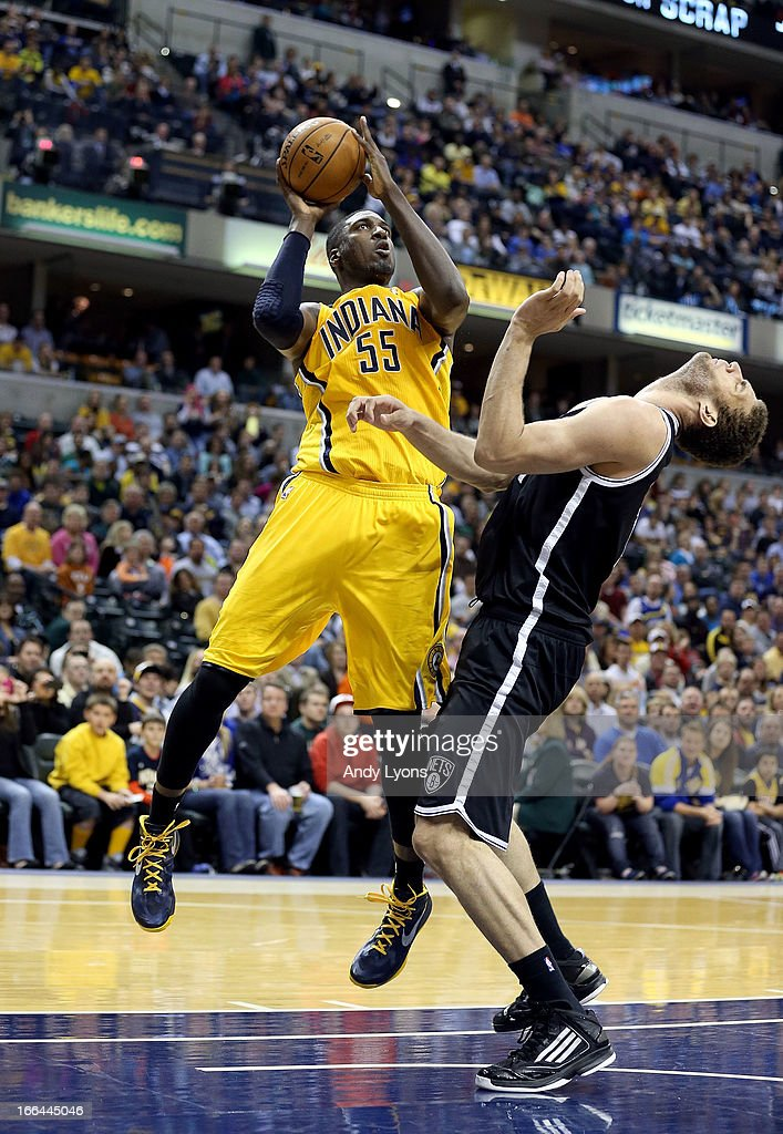<a gi-track='captionPersonalityLinkClicked' href=/galleries/search?phrase=Roy+Hibbert&family=editorial&specificpeople=725128 ng-click='$event.stopPropagation()'>Roy Hibbert</a> #55 of the Indiana Pacers shoots the ball while defended by <a gi-track='captionPersonalityLinkClicked' href=/galleries/search?phrase=Brook+Lopez&family=editorial&specificpeople=3847328 ng-click='$event.stopPropagation()'>Brook Lopez</a> # 11 of the Brooklyn Nets at Bankers Life Fieldhouse on April 12, 2013 in Indianapolis, Indiana.