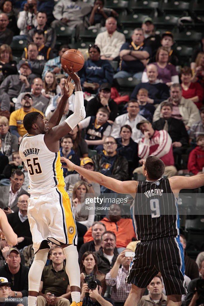 Roy Hibbert #55 of the Indiana Pacers takes a shot against Nikola Vucevic #9 of the Orlando Magic on March 19, 2013 at Bankers Life Fieldhouse in Indianapolis, Indiana.