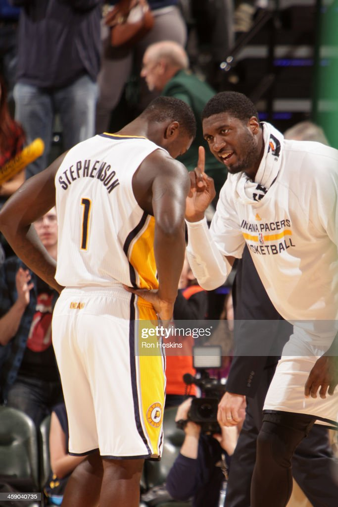 Roy Hibbert #55 of the Indiana Pacers talks with Lance Stephenson #1 during the game against the Boston Celtics at Bankers Life Fieldhouse on December 22, 2013 in Indianapolis, Indiana.