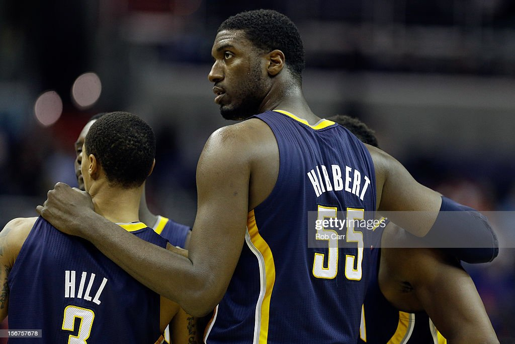 Roy Hibbert #55 of the Indiana Pacers talks with teammate George Hill #3 during a timeout against the Washington Wizards at Verizon Center on November 19, 2012 in Washington, DC.