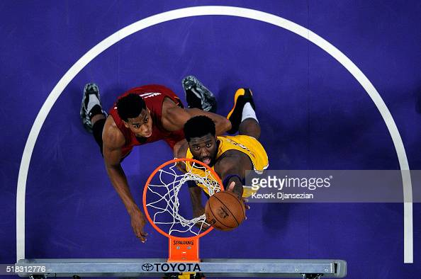 Roy Hibbert of the Los Angeles Lakers tips in a basket against Hassan Whiteside of the Miami Heat during the second half of the basketball game at...