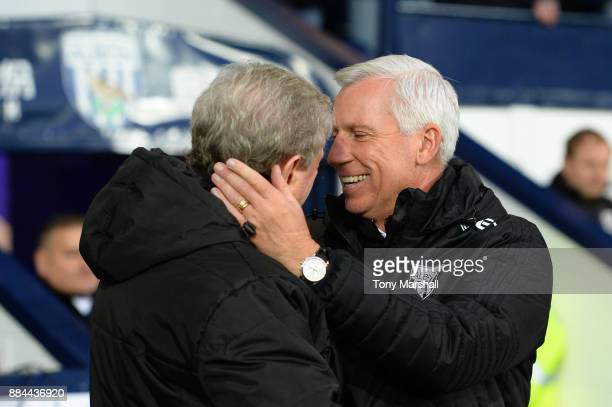 Roy Hodgson Manager of Crystal Palace and Alan Pardew Manager of West Bromwich Albion embrace prior to the Premier League match between West Bromwich...
