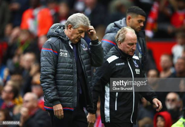 Roy Hodgson Manager of Crystal Palace scratches his head at the half time during the Premier League match between Manchester United and Crystal...