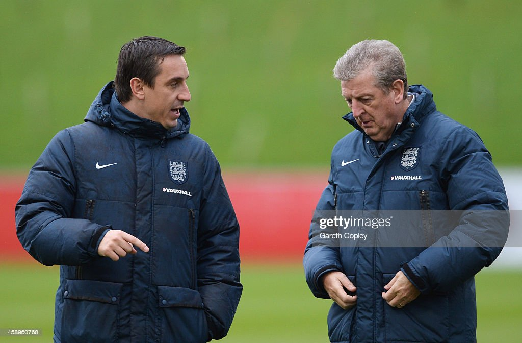 Roy Hodgson manager of England and coach Gary Neville in discussion during an England training session ahead of the UEFA European Championship...