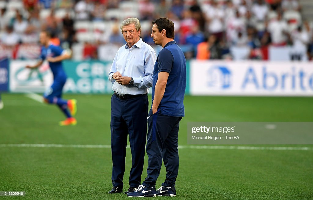 <a gi-track='captionPersonalityLinkClicked' href=/galleries/search?phrase=Roy+Hodgson&family=editorial&specificpeople=881703 ng-click='$event.stopPropagation()'>Roy Hodgson</a> (L) manager of England and <a gi-track='captionPersonalityLinkClicked' href=/galleries/search?phrase=Gary+Neville&family=editorial&specificpeople=171409 ng-click='$event.stopPropagation()'>Gary Neville</a> (R), assistant manager are seen prior to the UEFA EURO 2016 round of 16 match between England and Iceland at Allianz Riviera Stadium on June 27, 2016 in Nice, France.