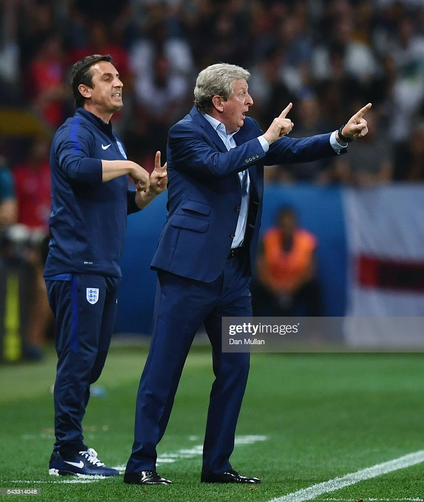 <a gi-track='captionPersonalityLinkClicked' href=/galleries/search?phrase=Roy+Hodgson&family=editorial&specificpeople=881703 ng-click='$event.stopPropagation()'>Roy Hodgson</a> manager of England and his assistant <a gi-track='captionPersonalityLinkClicked' href=/galleries/search?phrase=Gary+Neville&family=editorial&specificpeople=171409 ng-click='$event.stopPropagation()'>Gary Neville</a> instruct during the UEFA EURO 2016 round of 16 match between England and Iceland at Allianz Riviera Stadium on June 27, 2016 in Nice, France.