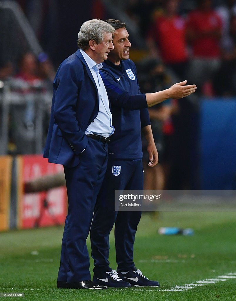 <a gi-track='captionPersonalityLinkClicked' href=/galleries/search?phrase=Roy+Hodgson&family=editorial&specificpeople=881703 ng-click='$event.stopPropagation()'>Roy Hodgson</a> manager of England and his assistant <a gi-track='captionPersonalityLinkClicked' href=/galleries/search?phrase=Gary+Neville&family=editorial&specificpeople=171409 ng-click='$event.stopPropagation()'>Gary Neville</a> talk during the UEFA EURO 2016 round of 16 match between England and Iceland at Allianz Riviera Stadium on June 27, 2016 in Nice, France.