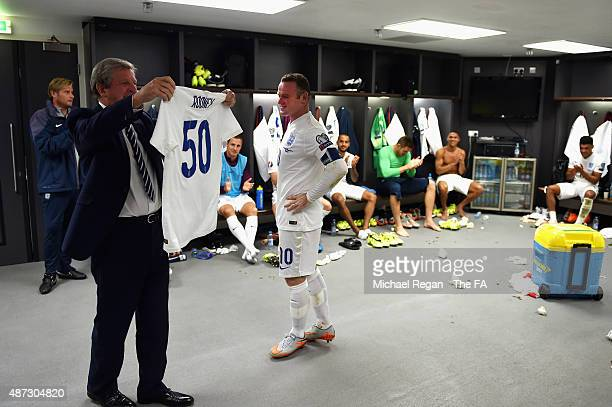 Roy Hodgson manager of England holds up an England shirt with the number 50 after Wayne Rooney broke the record of 49 goals set by Sir Bobby Charlton...
