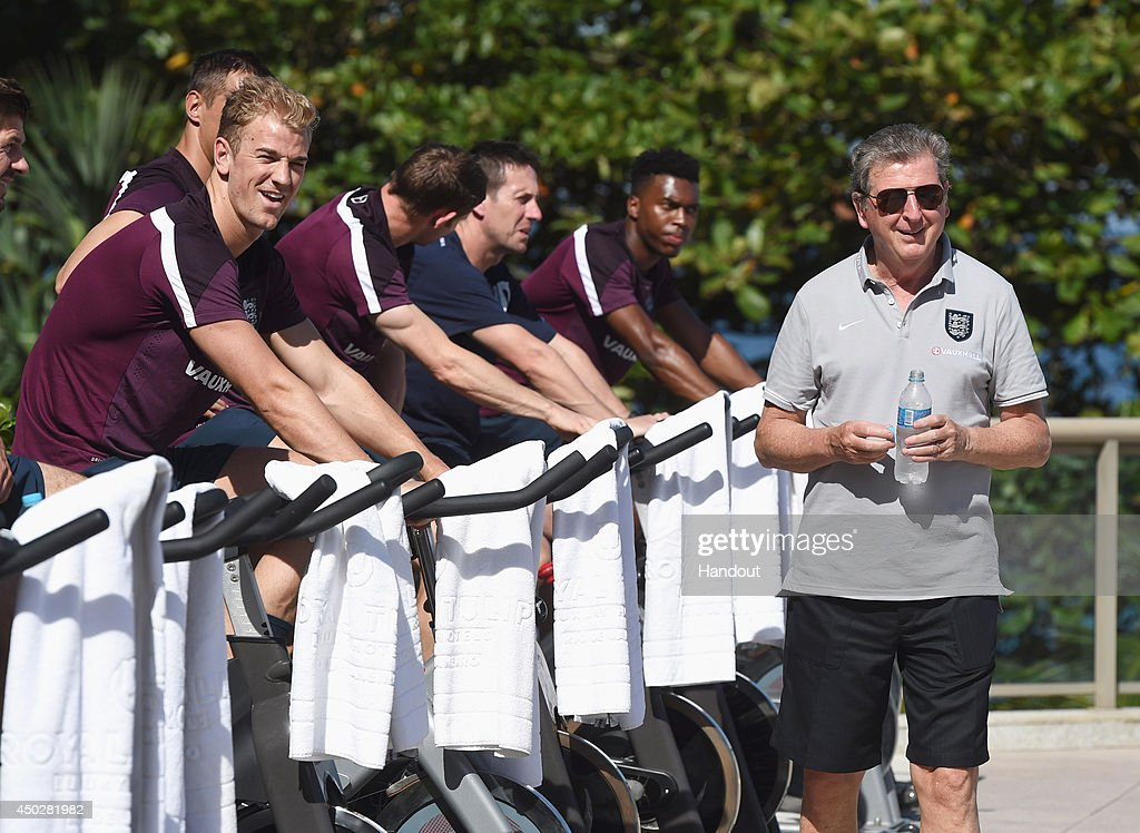 <a gi-track='captionPersonalityLinkClicked' href=/galleries/search?phrase=Roy+Hodgson&family=editorial&specificpeople=881703 ng-click='$event.stopPropagation()'>Roy Hodgson</a>, manager of England smiles with <a gi-track='captionPersonalityLinkClicked' href=/galleries/search?phrase=Joe+Hart&family=editorial&specificpeople=1295472 ng-click='$event.stopPropagation()'>Joe Hart</a> of England as he takes part in a recovery session at the Golden Tulip Hotel on June 8, 2014 in Rio de Janeiro, Brazil.