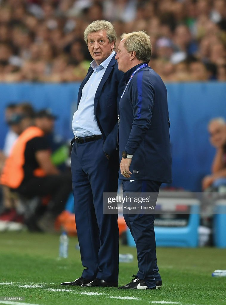 Roy Hodgson manager of England talks to assitant manager Ray Lewington during the UEFA EURO 2016 round of 16 match between England and Iceland at Allianz Riviera Stadium on June 27, 2016 in Nice, France.