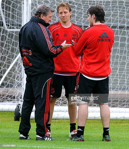 Roy Hodgson manager of Liverpool FC speaks with Lucas Leiva and Emiliano Insua during a training session on the day he was unveiled as the club's new...