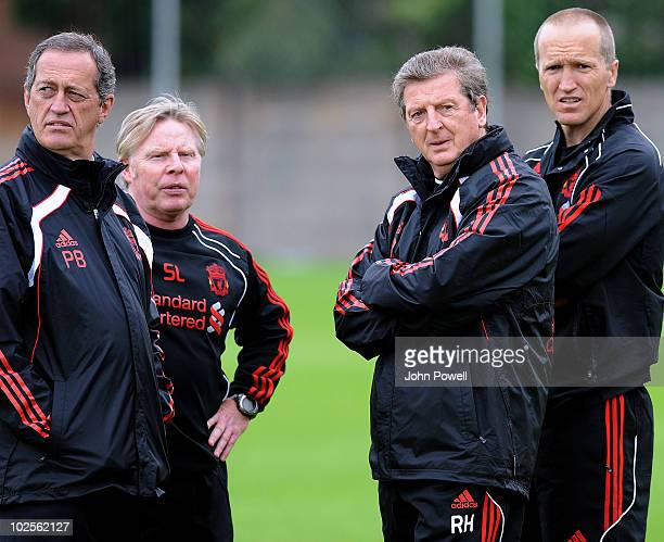 Roy Hodgson manager of Liverpool FC stands with Darren Burgess Head of Fitness and Conditioning Assistant Manager Sammy Lee and Peter Brukner Head of...