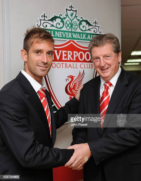Roy Hodgson manager of Liverpool shakes hands with new signing Raul Meireles at Anfield on August 29 2010 in Liverpool England