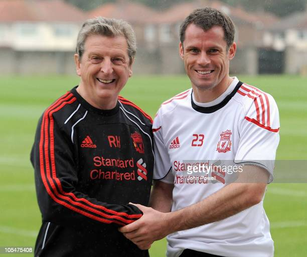 Roy Hodgson Manager of Liverpool with Jamie Carragher of Liverpool during a training session at Melwood training ground on October 15 2010 in...