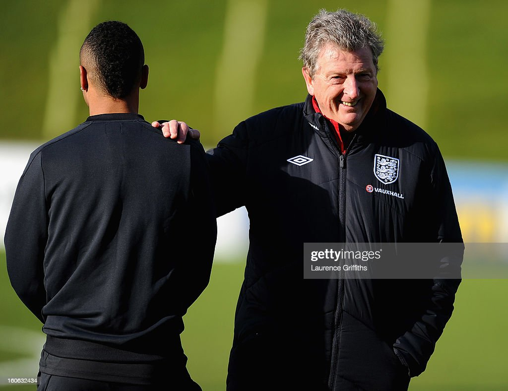 Roy Hodgson of England talks with Ashley Cole during a training session at St Georges Park on February 4, 2013 in Burton-upon-Trent, England.