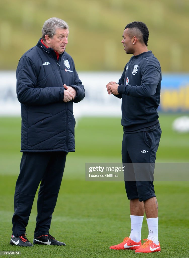 <a gi-track='captionPersonalityLinkClicked' href=/galleries/search?phrase=Roy+Hodgson&family=editorial&specificpeople=881703 ng-click='$event.stopPropagation()'>Roy Hodgson</a> of England talks with <a gi-track='captionPersonalityLinkClicked' href=/galleries/search?phrase=Ashley+Cole&family=editorial&specificpeople=201831 ng-click='$event.stopPropagation()'>Ashley Cole</a> during a training session at St Georges Park on March 19, 2013 in Burton-upon-Trent, England.