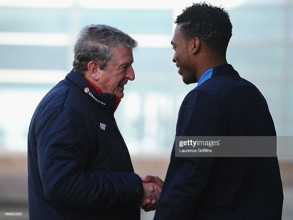 <a gi-track='captionPersonalityLinkClicked' href=/galleries/search?phrase=Roy+Hodgson&family=editorial&specificpeople=881703 ng-click='$event.stopPropagation()'>Roy Hodgson</a> of England talks with <a gi-track='captionPersonalityLinkClicked' href=/galleries/search?phrase=Daniel+Sturridge&family=editorial&specificpeople=677270 ng-click='$event.stopPropagation()'>Daniel Sturridge</a> during a training session at St Georges Park on February 4, 2013 in Burton-upon-Trent, England.
