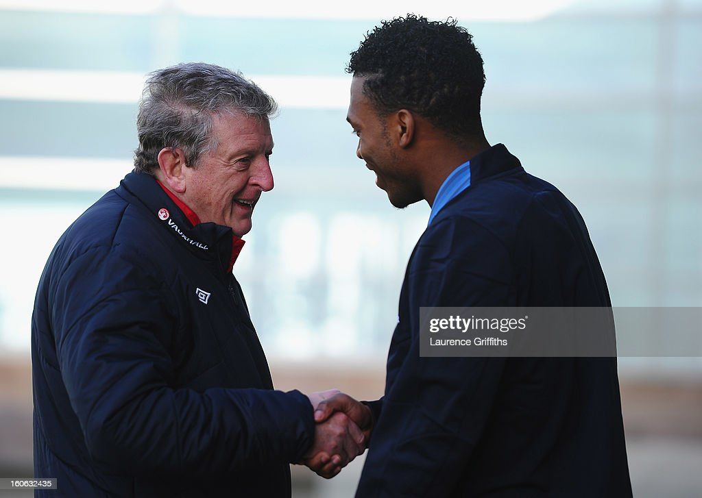 <a gi-track='captionPersonalityLinkClicked' href=/galleries/search?phrase=Roy+Hodgson&family=editorial&specificpeople=881703 ng-click='$event.stopPropagation()'>Roy Hodgson</a> of England talks with <a gi-track='captionPersonalityLinkClicked' href=/galleries/search?phrase=Daniel+Sturridge+-+Soccer+Player&family=editorial&specificpeople=677270 ng-click='$event.stopPropagation()'>Daniel Sturridge</a> during a training session at St Georges Park on February 4, 2013 in Burton-upon-Trent, England.