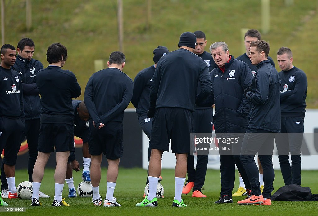 Roy Hodgson of England talks with the team during a training session at St Georges Park on March 19, 2013 in Burton-upon-Trent, England.