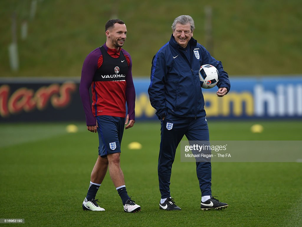 Roy Hodgson of England welcomes Danny Drinkwater of England during England training session and press conference at St Georges Park on March 22 2016...