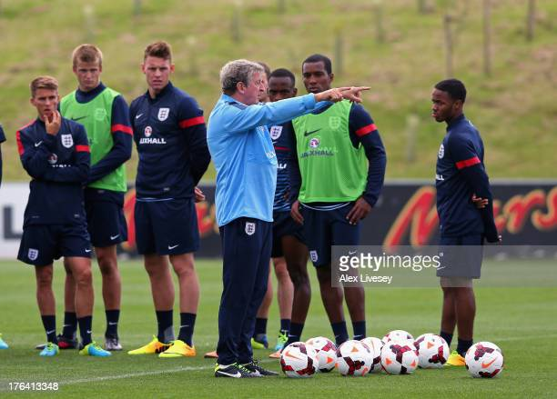 Roy Hodgson the manager of England directs the England U21's team during a training session at St Georges Park on August 12 2013 in BurtonuponTrent...