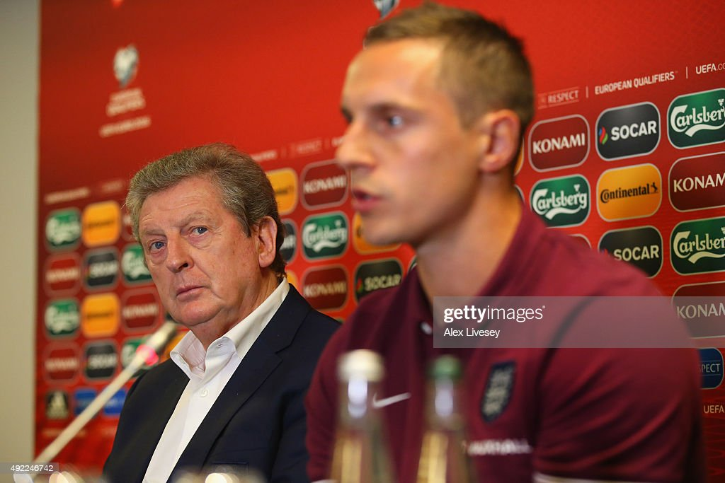 <a gi-track='captionPersonalityLinkClicked' href=/galleries/search?phrase=Roy+Hodgson&family=editorial&specificpeople=881703 ng-click='$event.stopPropagation()'>Roy Hodgson</a> the manager of England looks over to <a gi-track='captionPersonalityLinkClicked' href=/galleries/search?phrase=Phil+Jagielka&family=editorial&specificpeople=682518 ng-click='$event.stopPropagation()'>Phil Jagielka</a> whom he's made captain for the game against Lituania during a press conference at the Novotel Vilnius Centre on October 11, 2015 in Vilnius, Lithuania.