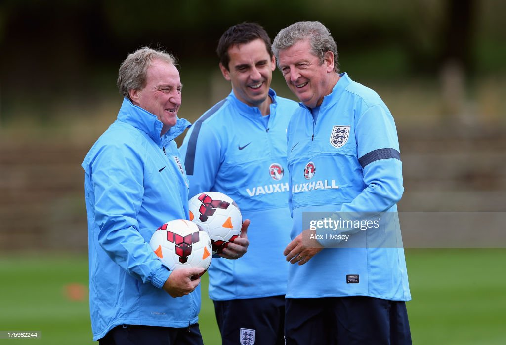 <a gi-track='captionPersonalityLinkClicked' href=/galleries/search?phrase=Roy+Hodgson&family=editorial&specificpeople=881703 ng-click='$event.stopPropagation()'>Roy Hodgson</a> the manager of England U21 shares a joke with his assistants, <a gi-track='captionPersonalityLinkClicked' href=/galleries/search?phrase=Ray+Lewington&family=editorial&specificpeople=224730 ng-click='$event.stopPropagation()'>Ray Lewington</a> and <a gi-track='captionPersonalityLinkClicked' href=/galleries/search?phrase=Gary+Neville&family=editorial&specificpeople=171409 ng-click='$event.stopPropagation()'>Gary Neville</a>, during a England U21's training session at St Georges Park on August 11, 2013 in Burton-upon-Trent, England.