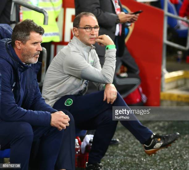 LR Roy Keane Assistant manager and Martin O'Neill manager of Republic of Ireland during Ireland supporters celebrate the teams win at full time FIFA...