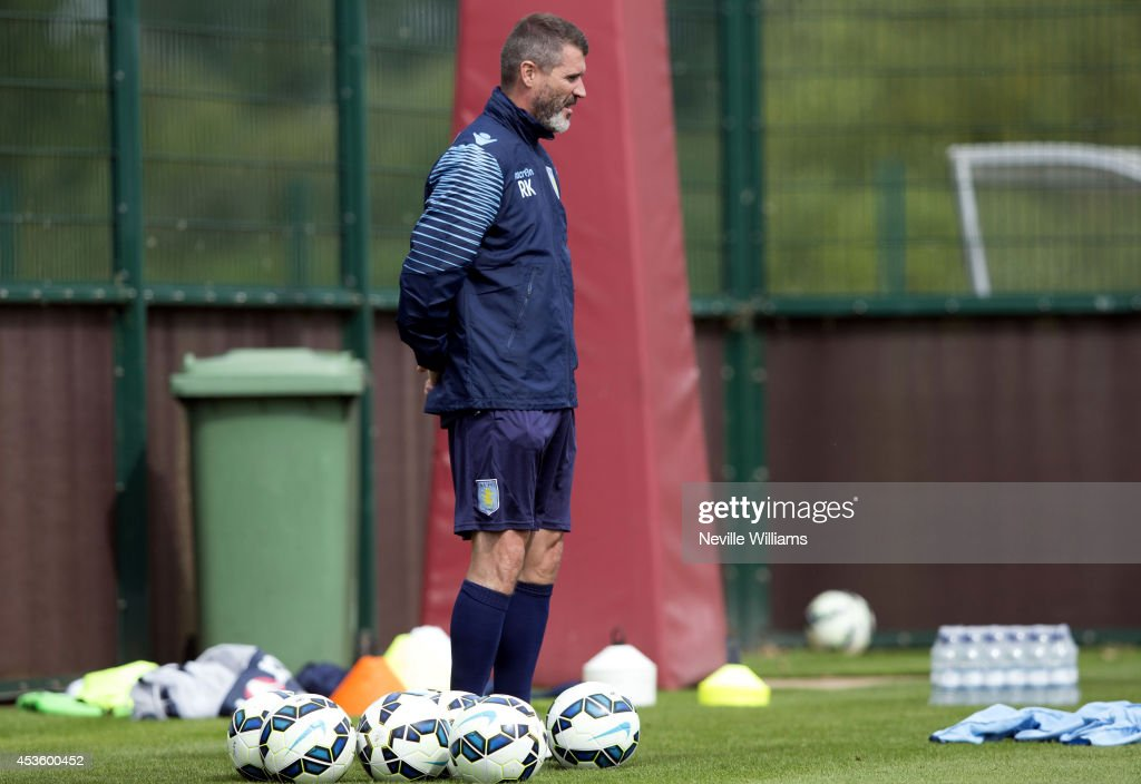 Roy Keane, assistant manager of Aston Villa wwatches the players in action during a Aston Villa training session at the club's training ground at Bodymoor Heath on August 14, 2014 in Birmingham, England.