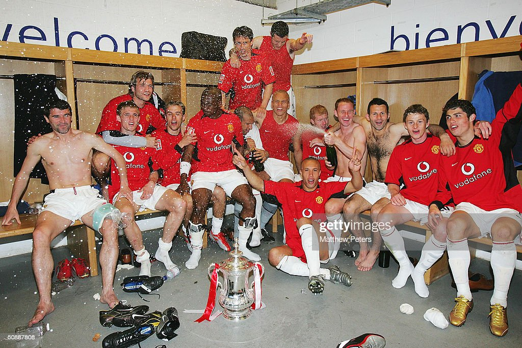 Roy Keane, Darren Fletcher, Roy Carroll, Phil Neville, Eric Djemba-Djemba, Gary Neville, John O'Shea, Wes Brown, Mikael Silvestre, Nicky Butt, Ryan Giggs, Ole Gunnar Solskjaer and Cristiano Ronaldo of Manchester United celebrate with the FA Cup after winning the AXA FA Cup Final between Manchester United and Millwall at the Millennium Stadium on May 22, 2004 in Cardiff, Wales.