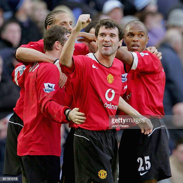 Roy Keane of Manchester United celebrates with Wayne Rooney Rio Ferdinand and Quinton Fortune after Rooney's cross led to Richard Dunne scoring an...