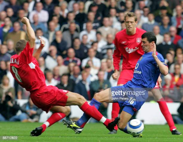 Roy Keane of Manchester United clashes with Steven Gerrard of Liverpool during the Barclays Premiership match between Liverpool and Manchester United...