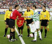Roy Keane of Manchester Unitedshakes hands with Jackie McNamara of Celtic ahead of the ChampionsWorld Series preseason friendly match against Celtic...