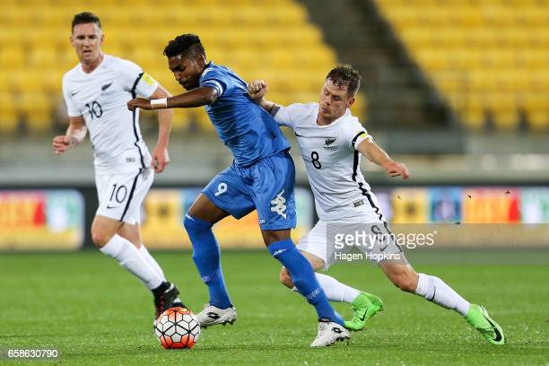 Roy Krishna of Fiji is tackled by Michael McGlinchey of New Zealand during the 2018 FIFA World Cup Qualifier match between the New Zealand All Whites...