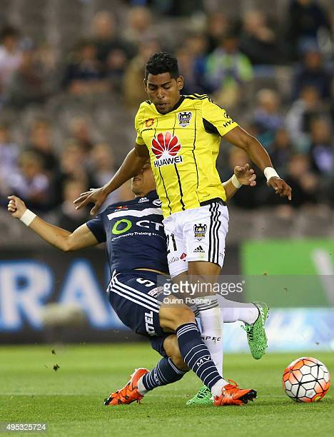 Roy Krishna of Phoenix is tackled by Daniel Georgievski of the Victory during the round four ALeague match between the Melbourne Victory and...