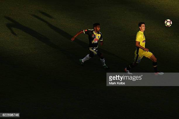Roy Krishna of the Phoenix and Michael Neill of the Mariners compete for the ball during the round six ALeague match between the Central Coast...